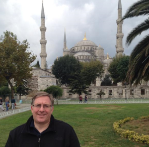 Standing in front of the famed Blue Mosque in Istanbul, Turkey.